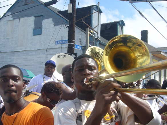 Derrick Tabb plays in the jazz funeral for Kerwin James in October 2007 while marching past the spot he was arrested days earlier.
